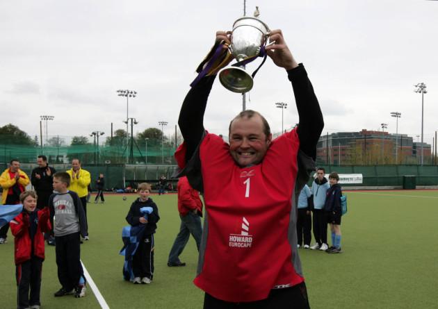 Goalkeeper Nigel Henderson raises the Irish Senior Cup