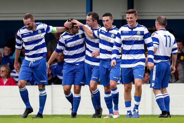 Sean Goulding celebrates scoring a goal with teammates