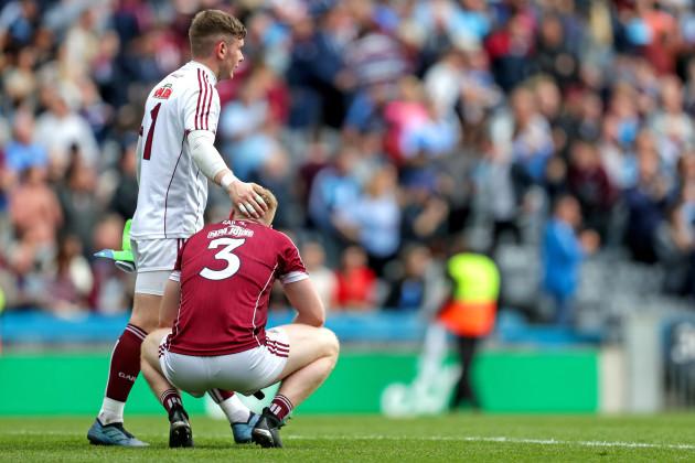 Ruairí Lavelle and Seán Andy Ó Ceallaigh dejected
