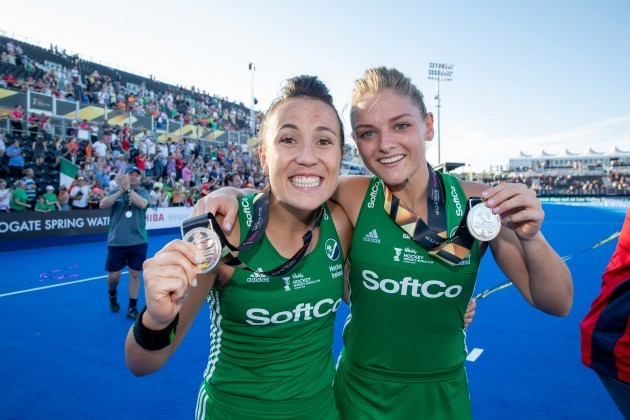 Anna O'Flanagan and Chloe Watkins celebrate with their silver medals