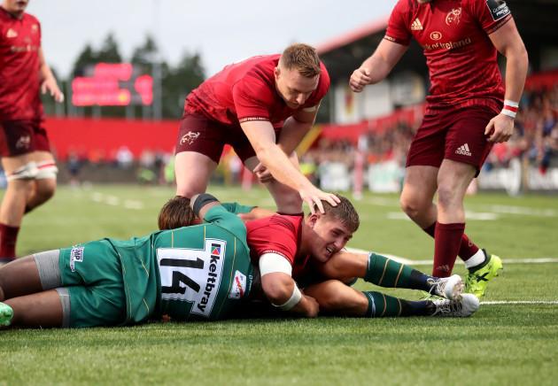Munster's Dan Goggin scores a try