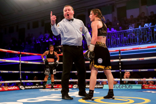 Referee Howard Foster deducts a point from Katie Taylor
