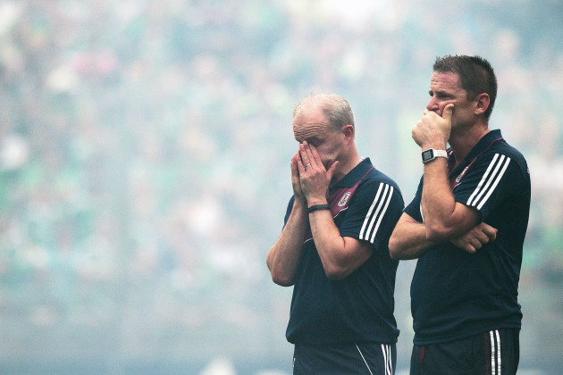 Michael Donoghue and selector Noel Larkin dejected at the end of the game