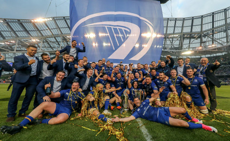 Leinster players celebrate with the PRO14 and Champions Cup trophies