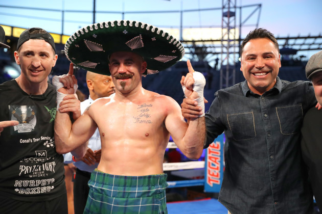 Gary O'Sullivan celebrates with trainer Paschal Collins and Oscar De La Hoya