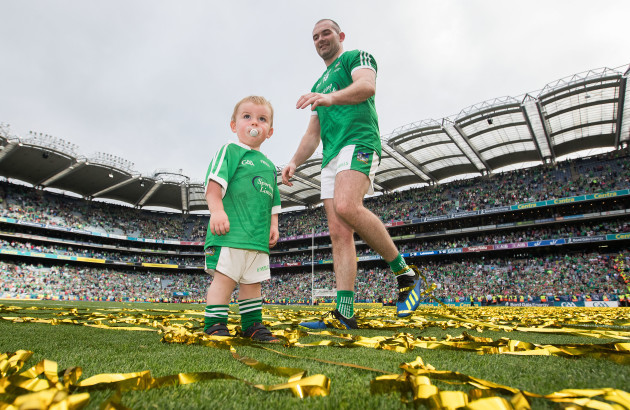 Tom Condon celebrates after the game with his son Nicky