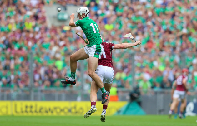 Kyle Hayes collides in the air with Joe Canning