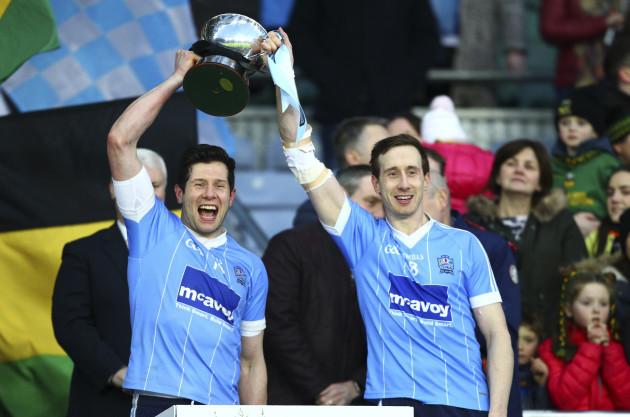 Sean Cavanagh and Colm Cavanagh raise the All Ireland Intermediate trophy