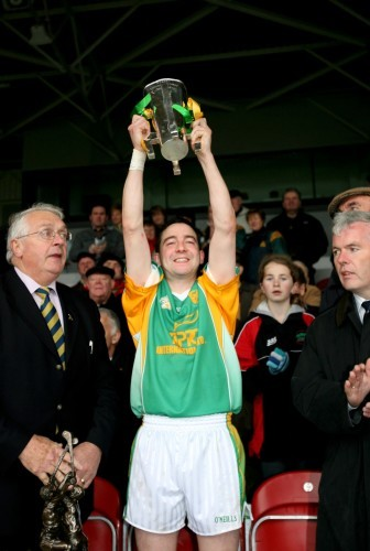 Michael Bevans lifts the cup