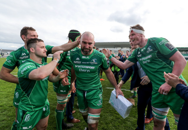 John Muldoon celebrates with teammates after the game