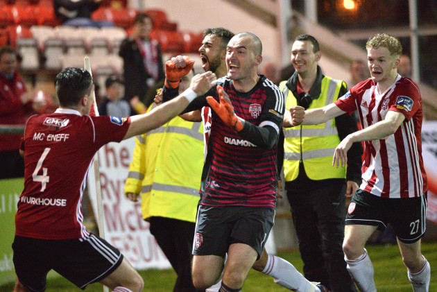 Gerard Doherty celebrates saving a last minute penalty with teammates