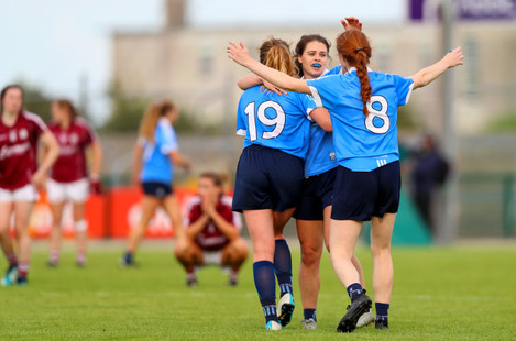 Noelle Healy, Lauren Magee and Sinead Finnegan celebrate at the final whistle