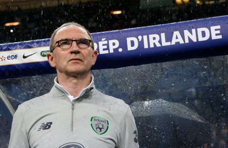 Martin O'Neill stands for the national anthem