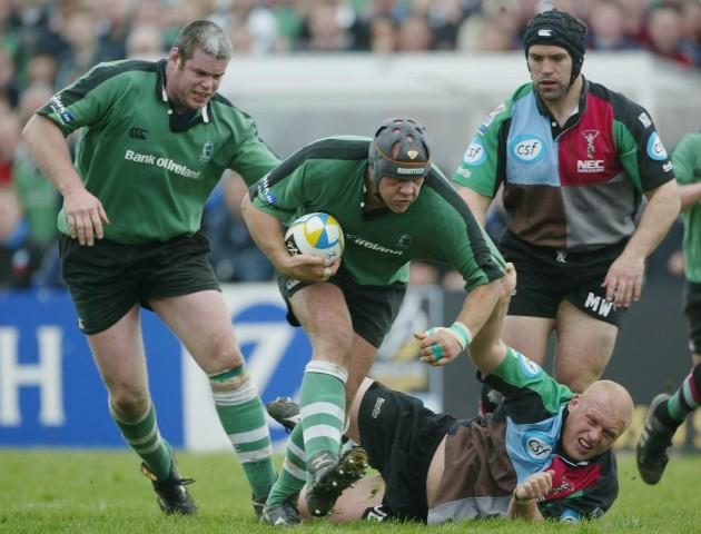 Dan McFarland and Peter Bracken charge past Jon Dawson