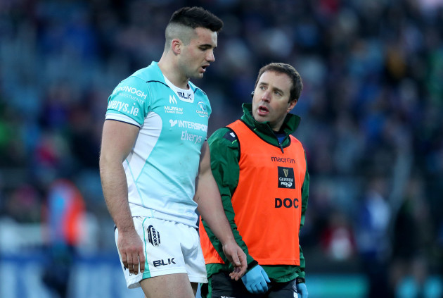Cian Kelleher leaves the pitch injured