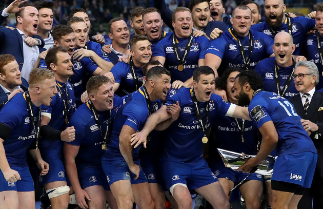 Leinster team celebrate on the podium with the trophy