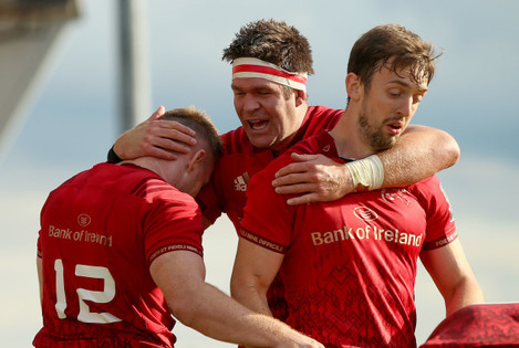 Rory Scannell celebrates scoring a try with Darren Sweetnam and Billy Holland