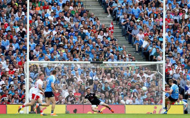 Paul Mannion scores a first half penalty past goalkeeper Niall Morgan