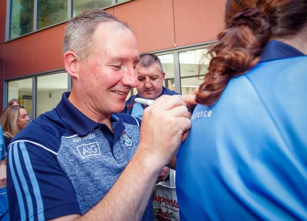 Jim Gavin signs a jersey