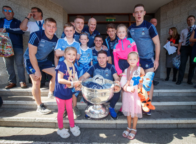 Members of the Dublin team with young fans and the Sam Maguire outside Our Lady's Children's Hospital Crumlin