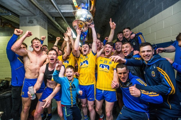 Roscommon celebrate after the game in the changing room with the trophy