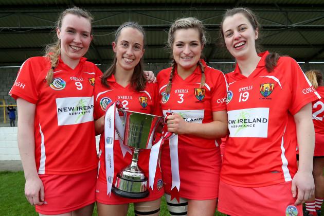 Sarah Buckley, Leah Weste, Sarah Harrington and Finola Neville celebrate winning the League 2 title