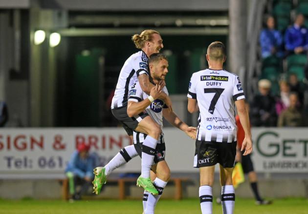 John Mountney celebrates scoring their third goal with Dane Massey