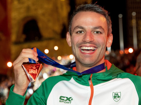 Thomas Barr with his bronze medal