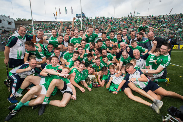 Limerick celebrates after the game with the Liam MacCarthy