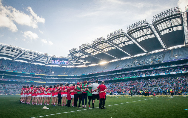 The Cork team stand during the trophy presentation
