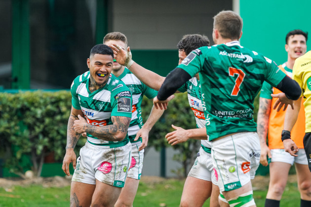 Monty Ioane celebrates scroring a try with teammates