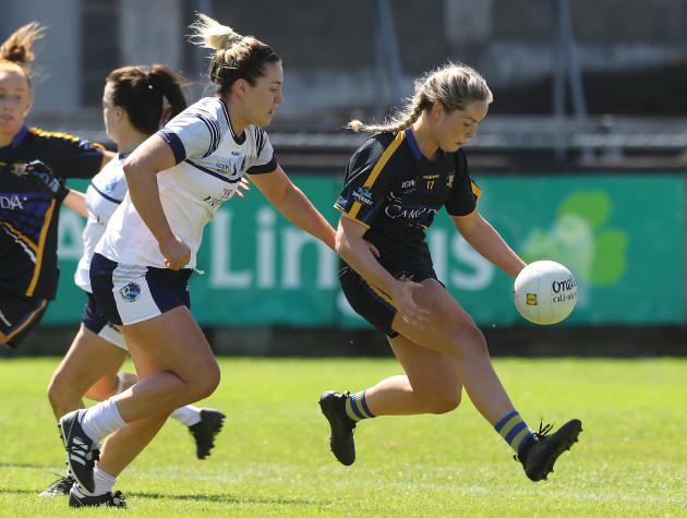 Grainne McGlade tackles Aisling McCarthy