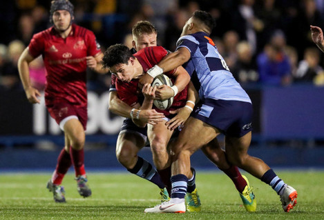 Joey Carbery tackled by Gareth Anscombe and Willis Halaholo