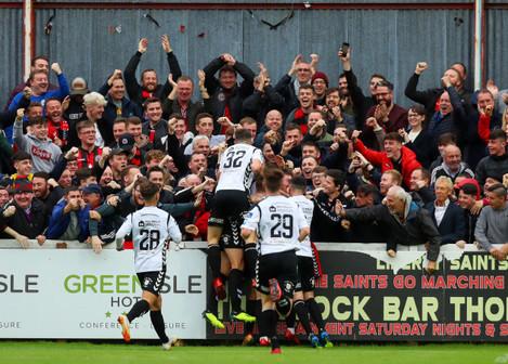 Ali Reghba celebrates scoring a goal with the fans