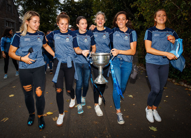 Danielle Lawless, Kate Sullivan, Sinead Aherne, Nicole Owens, Niamh McEvoy and Ciara Lynch bring the trophy into St.Sylvesters' GAA Pitch