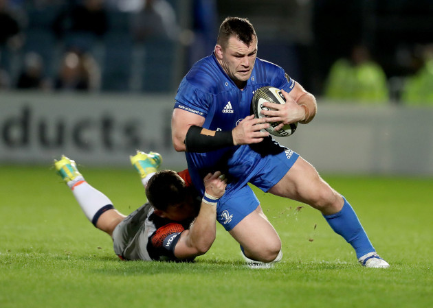 Cian Healy tackled by Magnus Bradbury