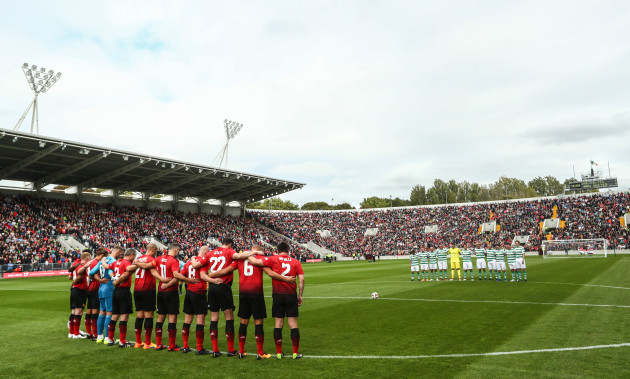 The teams observe a minute's silence