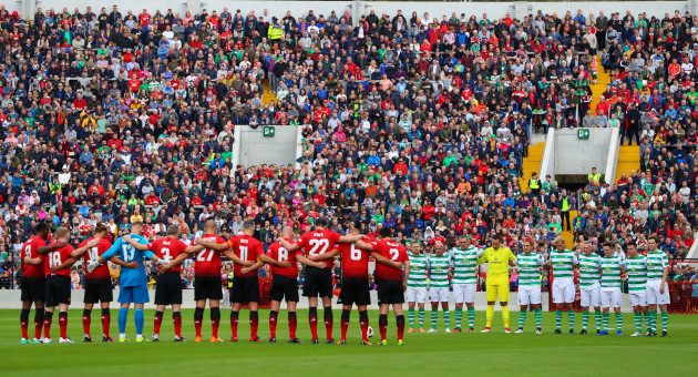 The two teams stand for a minute's silence
