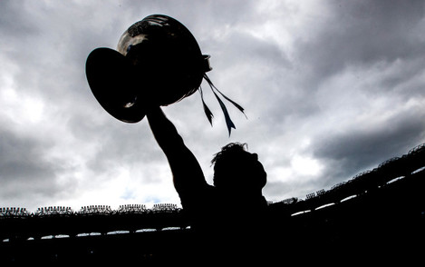 Michael Darragh Macauley celebrates with the Sam Maguire