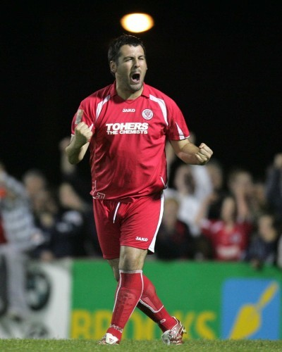 Keith Foy celebrates scoring a penalty