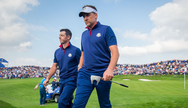 Rory McIlroy and Ian Poulter leave the 11th green