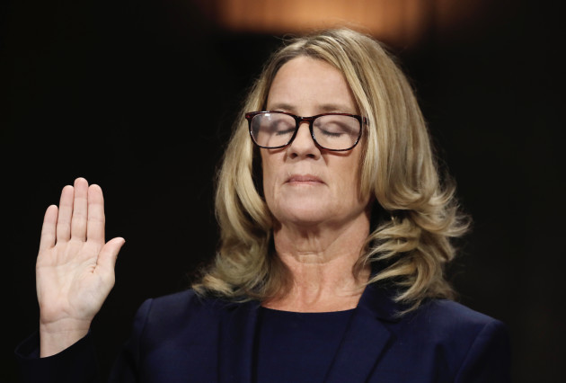 Christine Blasey Ford is sworn in before testifying to the Senate Judiciary Committee on Capitol Hill in Washington