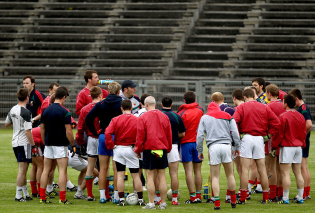 Manager James Horan speaks to his team during traininig