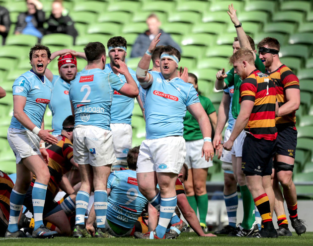 Garryowen players react to a play made by Lansdowne
