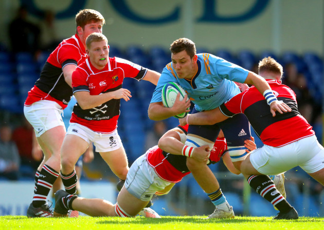Travis Cooney tackles Stephen McVeigh