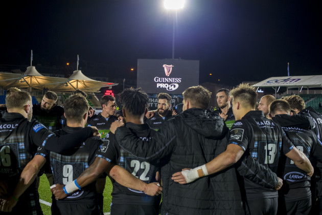 The Glasgow Warriors team huddle after the game