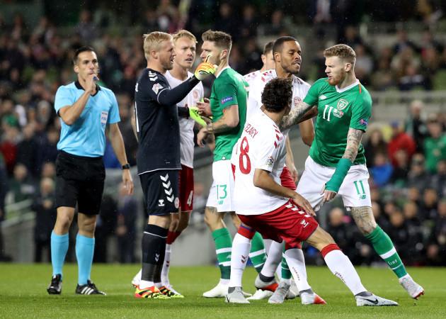 James McClean clashes with Kasper Schmeichel, Thomas Delaney and Mathias Jorgensen