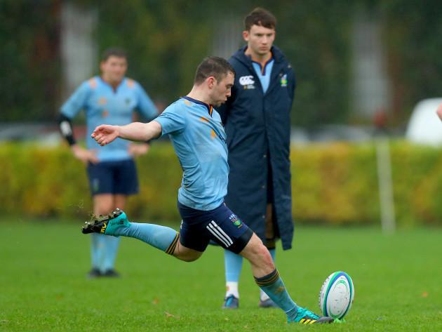 Cillian Burke kicks a conversion