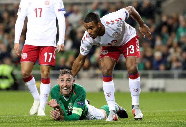 Richard Keogh shows his frustration with Mathias Jorgensen