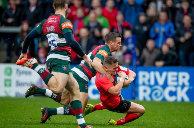 Michael Lowry is tackled high by George Ford